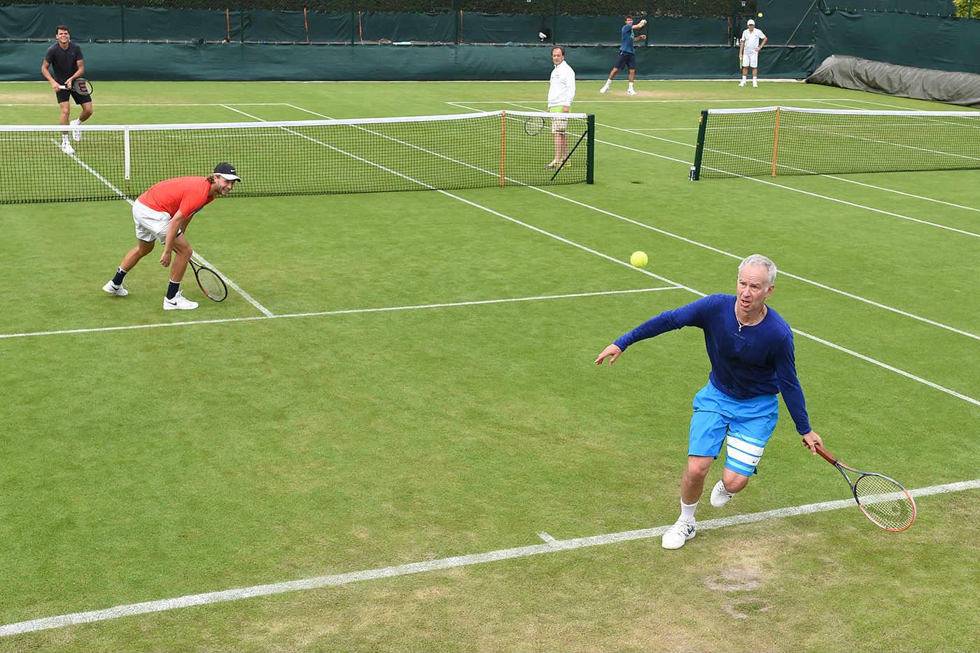 Milos Raonic con il suo nuovo allenatore, John McEnroe, tre volte campione a Wimbledon